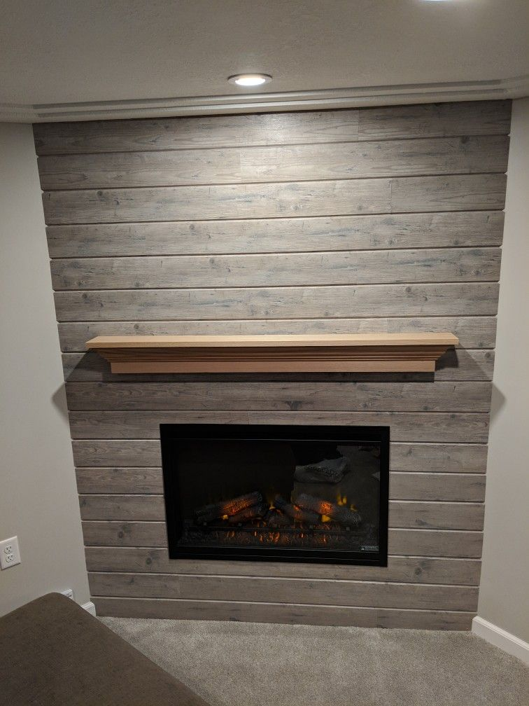 Electric Fireplace with oak mantle on a shiplap accent