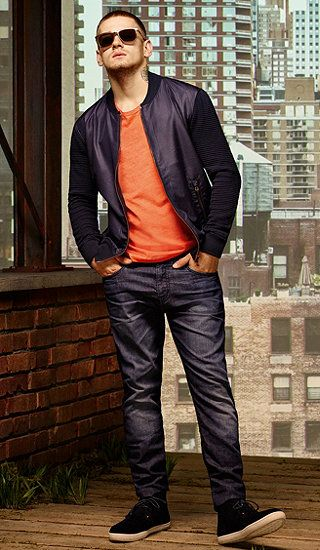 Blue bomber jacket, orange T-shirt with dark blue jeans and dark blue sneakers byBOSSOrange