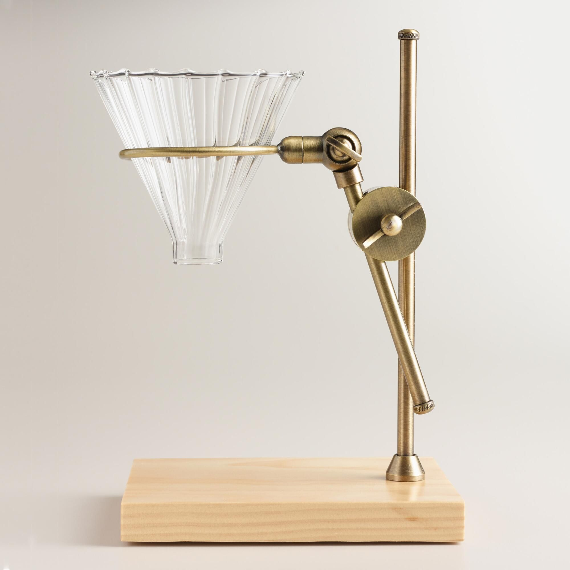 Crafted with an adjustable, industrialstyle brass arm, a