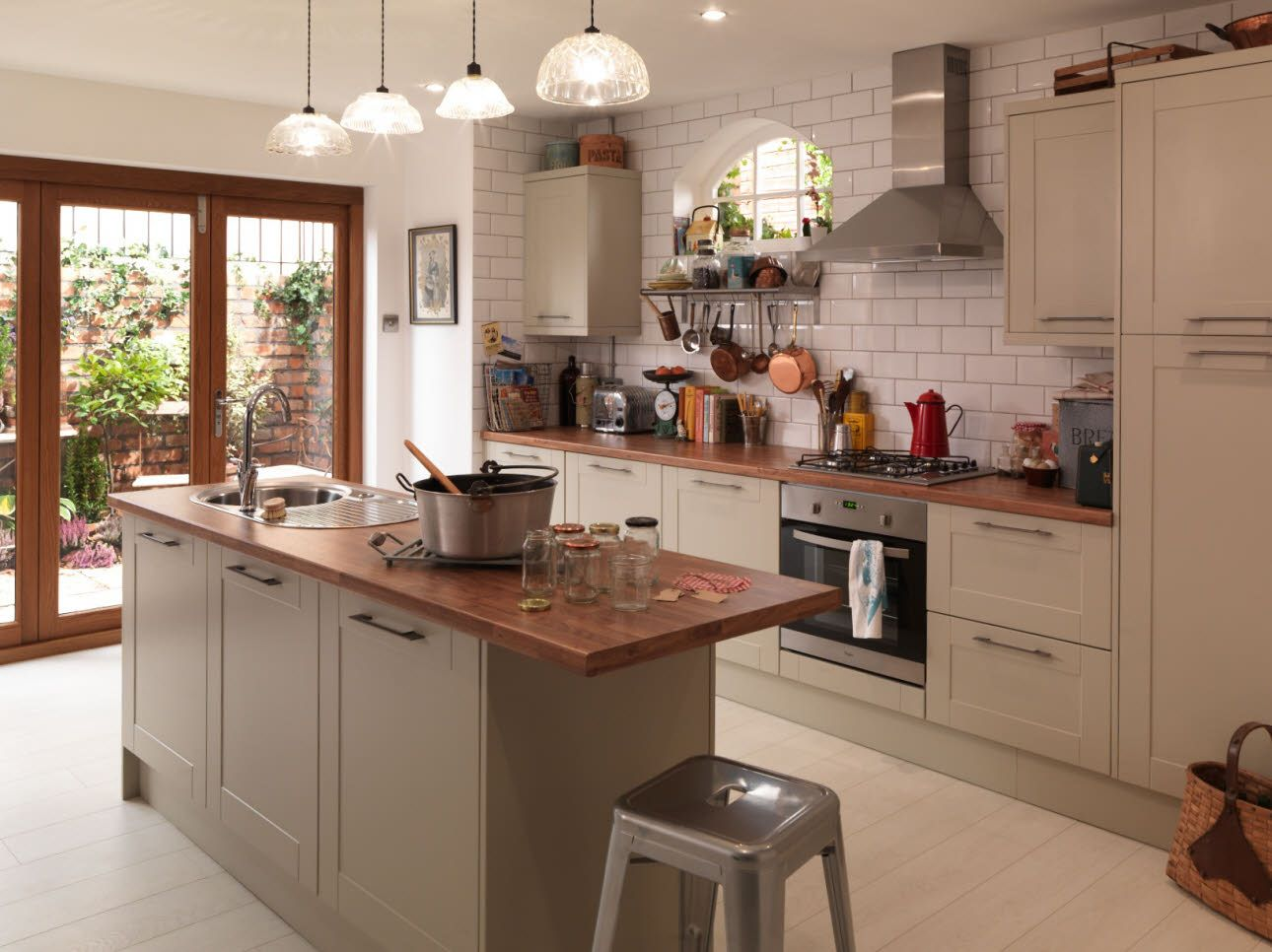 Copper pans and accessories brighten up a room, as shown with the Grey  Shaker kitchen