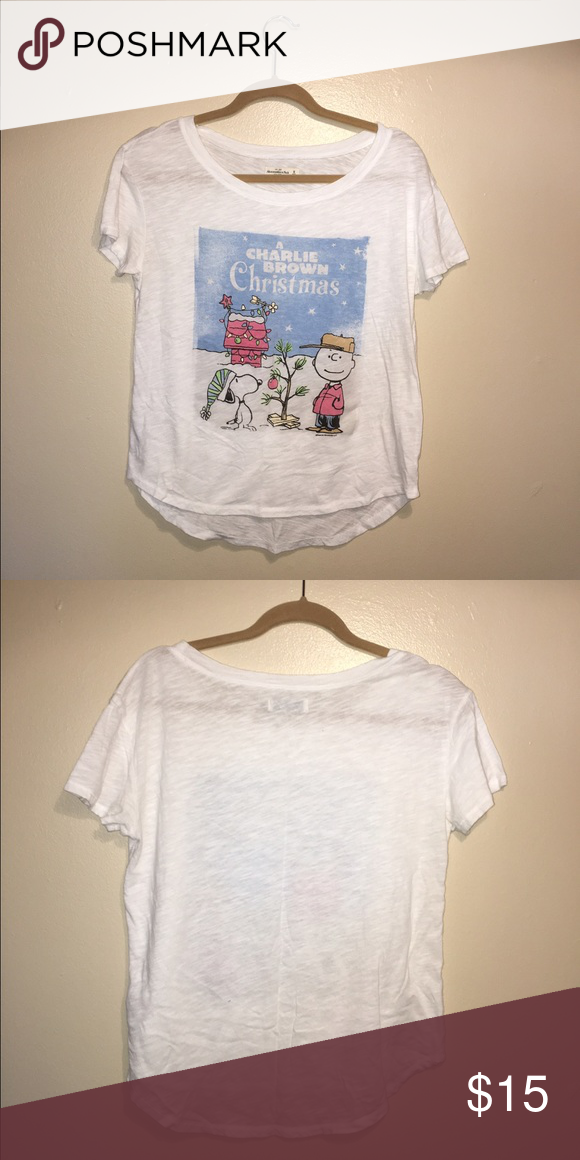 """Abercrombie and Fitch Charlie Brown Christmas Tee This adorable """"Charlie Brown Christmas"""" tee by Abercrombie and Fitch is simply adorable! Sheer white tee shirt with graphic detailing is the perfect piece for every Christmas loving girl! It may be a bit early (or late depending on how you look at it) to stock up on Christmas gear, but how can you pass this adorable and timeless piece!? Perfect condition! Never worn! Abercrombie & Fitch Tops Tees - Short Sleeve"""