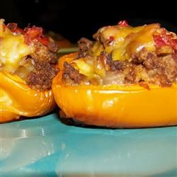 Fiesta Stuffed Peppers...with salsa, sour cream and guac on top!