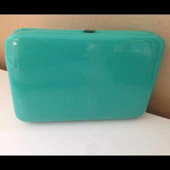 NWOT Mint Green clutch wallet Mint green clutch with Wallet slots. Brand new! Bags Clutches & Wristlets