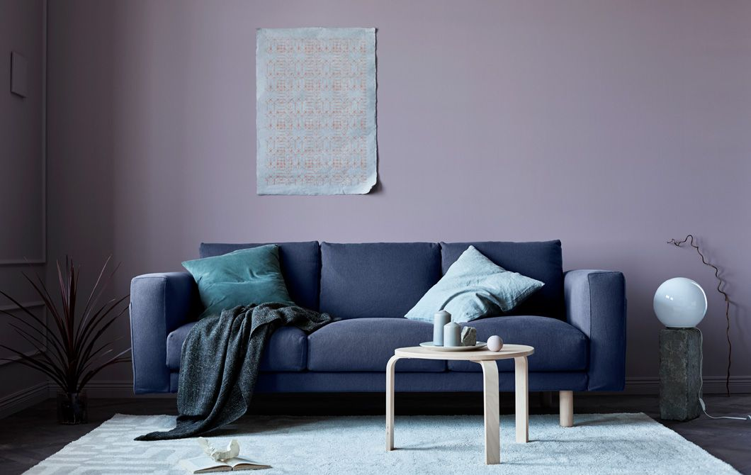 A Living Room Updated For Fall With A Gray Sofa, Pink Walls, Blankets And  Natural Elements