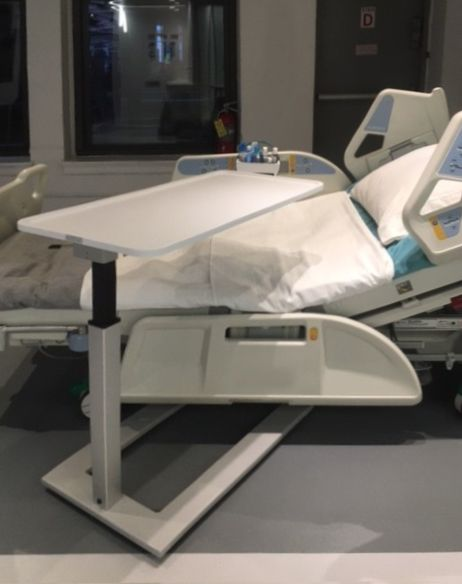 Futrus Guardian Overbed Table - 100% Corian Solid Surface table top. Ideal for high-risk area of infection.