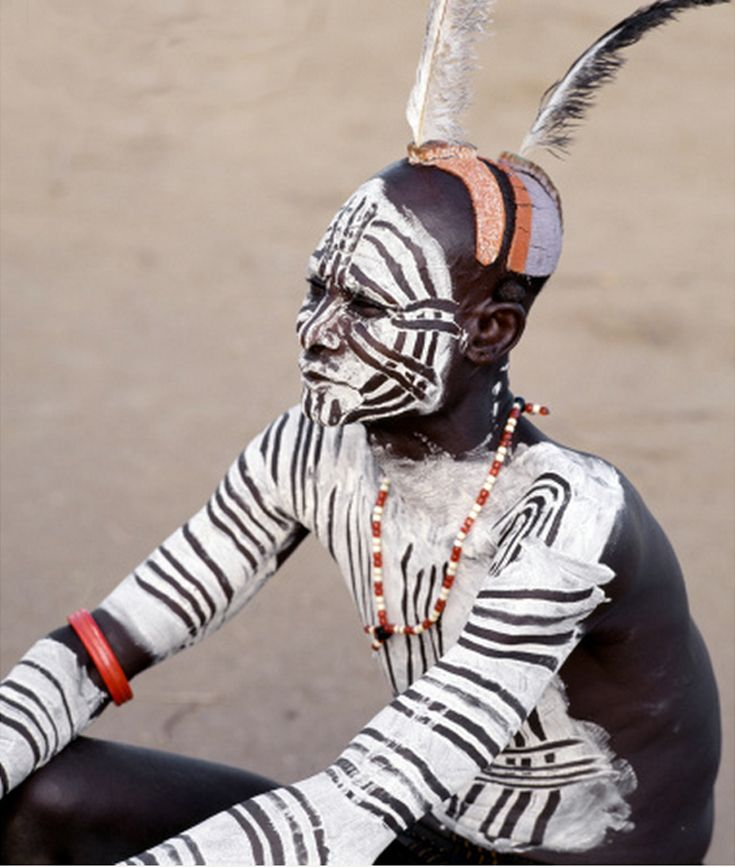 Africa | Karo men excel in body art. They decorate their faces and torsos elaborately using local white chalk, pulverised rock and other natural pigments. Omo River, Southwest Ethiopia | ©Nigel Pavitt