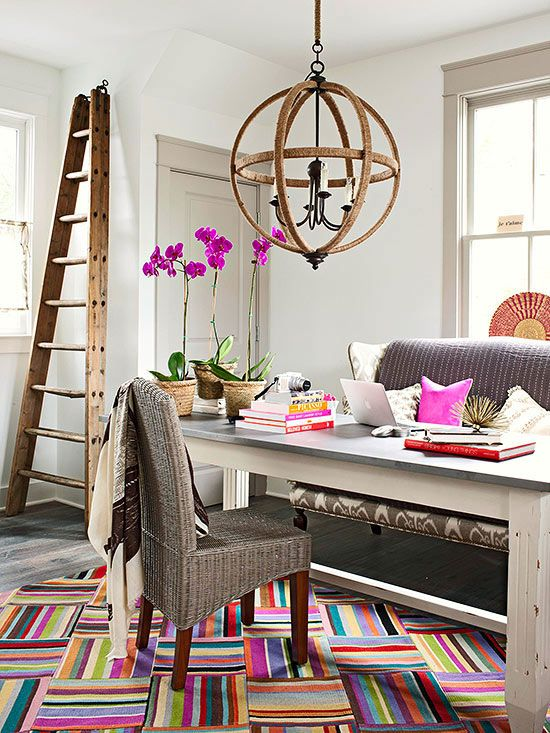 In addition to being a versatile wall color, gray also plays well on colorful decor in this living room.