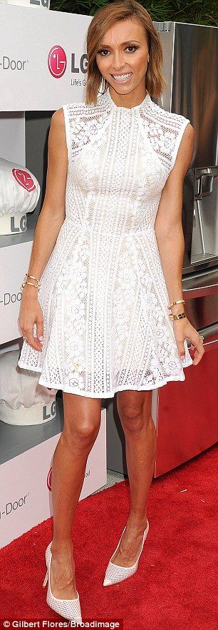 White hot: Giuliana showed off her slender figure in a lacy white mini-dress which she matched with a  pair of white perforated leather heels