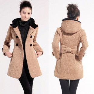 Peacoat. Love the bow on back! I also love how it has a hood. You don't see many peacoats with a cute hood.