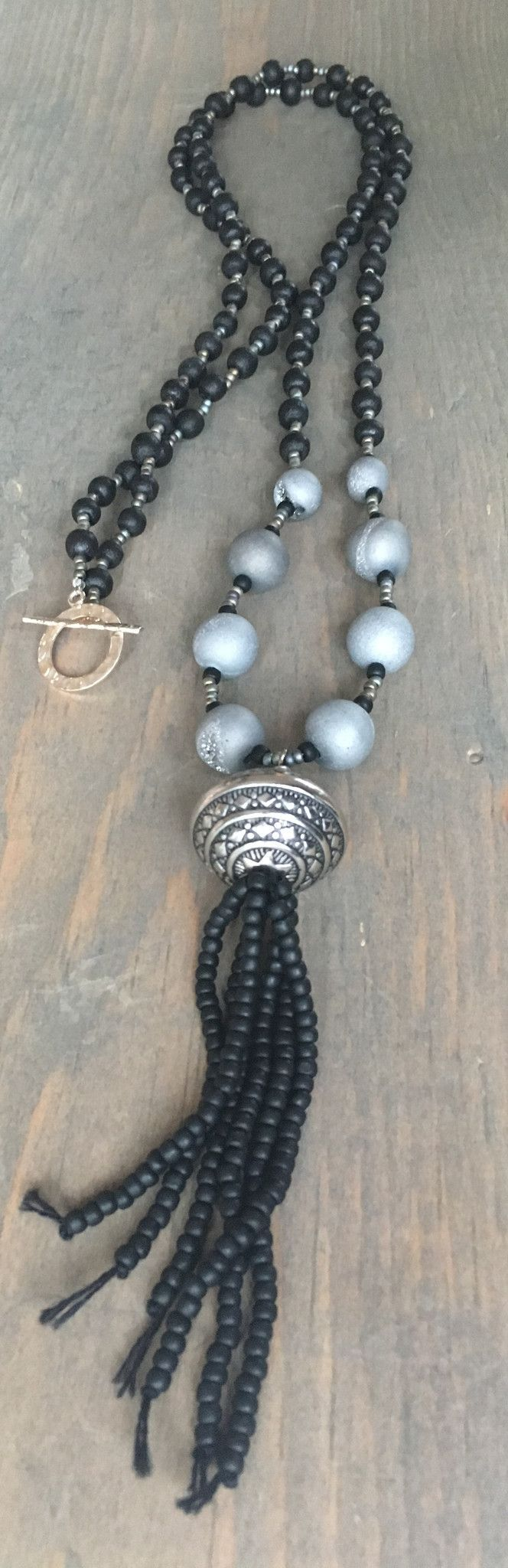 Beaded Necklace with toggle clasp and beaded tassel with black natural wood black beads and grey druzy agate beads