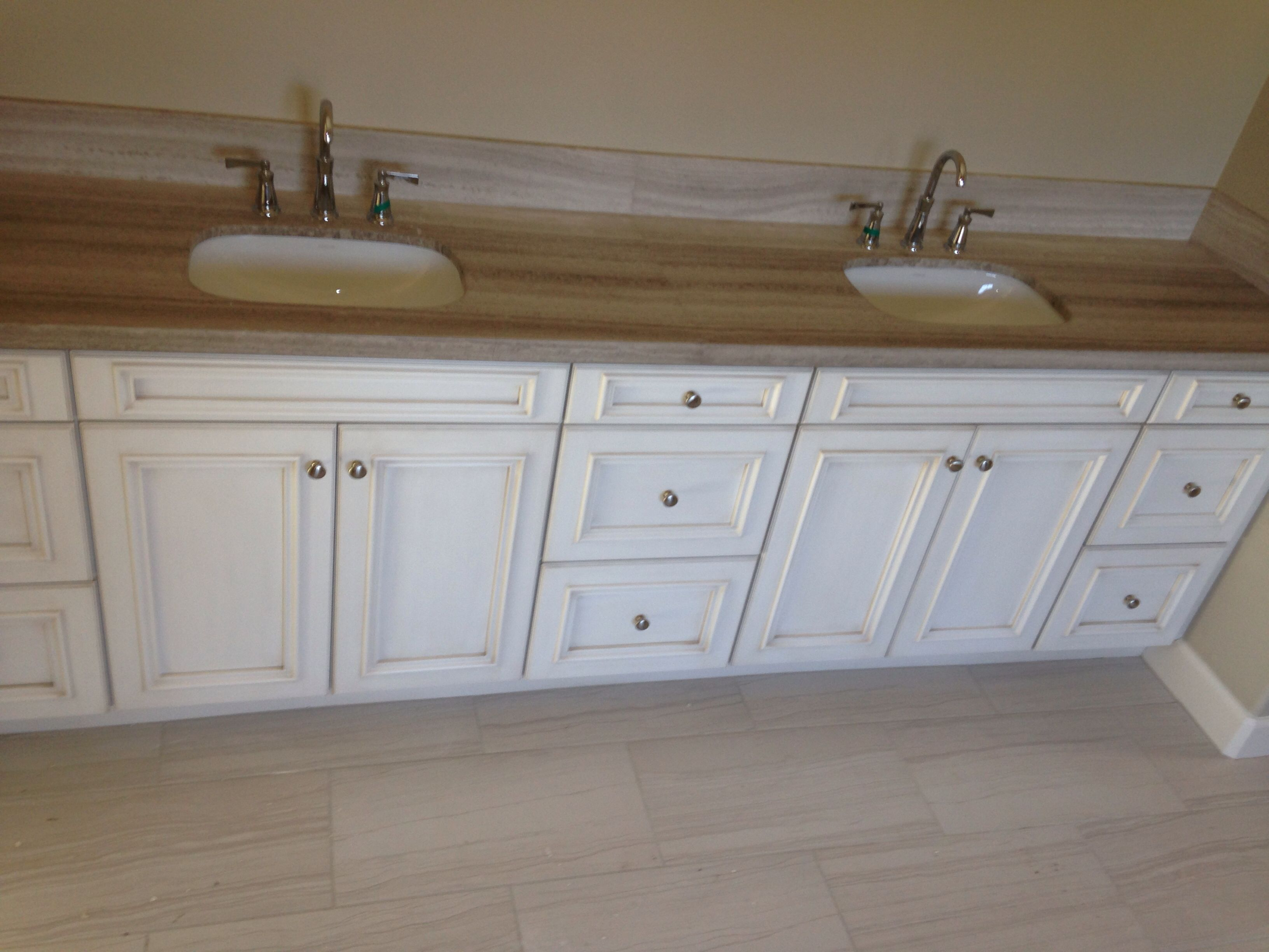 Master bath with antique white glazed cabinets, silver ...