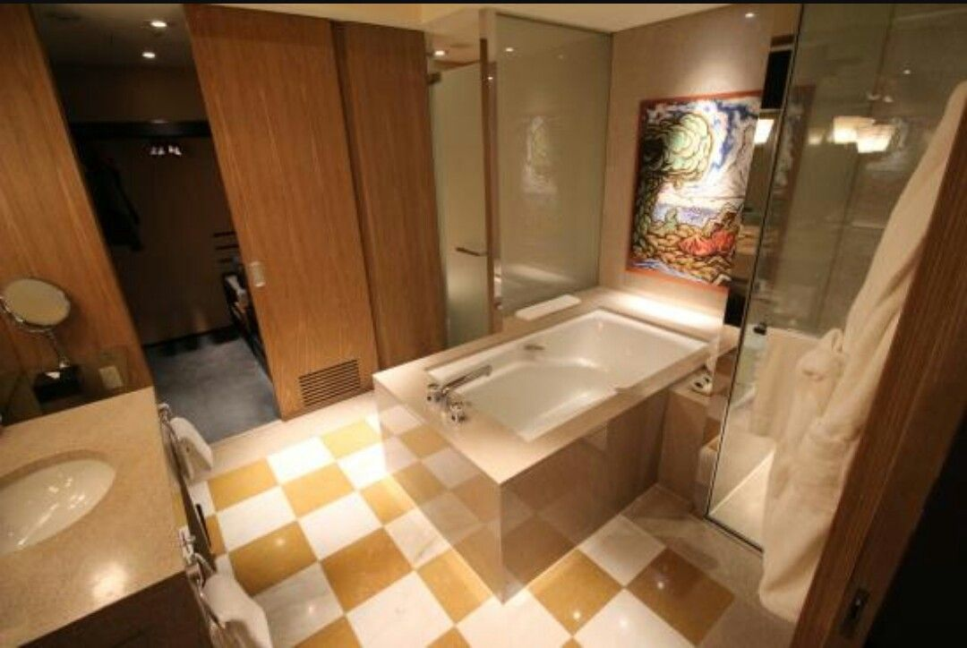We stayed at the Park Hyatt in Tokyo in December 2014. It was a really nice bathroom with a spacious bath and a big shower on one side of it. ..and the toilet on the other...both sectioned off in little glass cabins. They also had a bidet toilet...not for everyone but definitely need to give it a go at least once!
