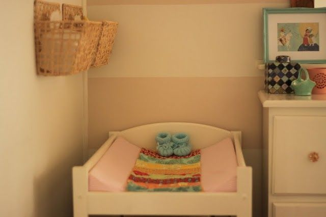 Hang supplies in baskets over the changing table-smart!  This is an awesome nursery btw!