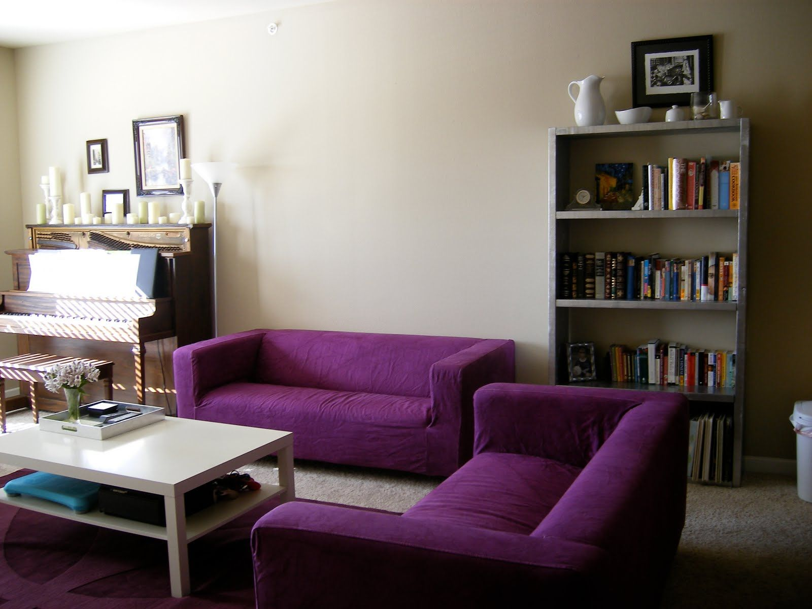 Purple couch, white table, ikea