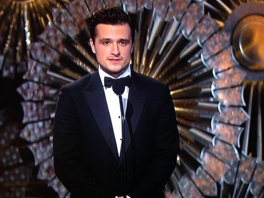 """Now here's a Peeta who won't throw paint on you - Josh Hutcherson!"" Neil Patrick Harris' introduction of Josh onto the Oscars stage. They played The Hanging Tree as he walked out!"