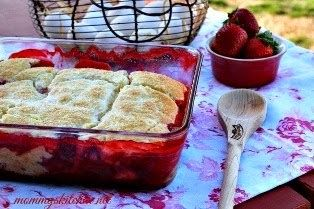 Strawberry Biscuit Cobbler {mommyskitchen.net}   Filling:   2 lbs - fresh strawberries, hulled, washed and quartered 1/2 - cup sugar 3 - tablespoons flour  Biscuit Topping:   1 1/2 - cups self rising flour, preferably White Lily flour  2 - tablespoon sugar, plus more for top of biscuits 4 - tablespoons cold and cubed butter 1 1/4 - cups cold heavy cream  8x8 or 9x9 inch baking dish