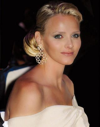 Charlene Princess of Monaco - she actually looks fairly happy in this photo, most of the time she looks sad or bored.