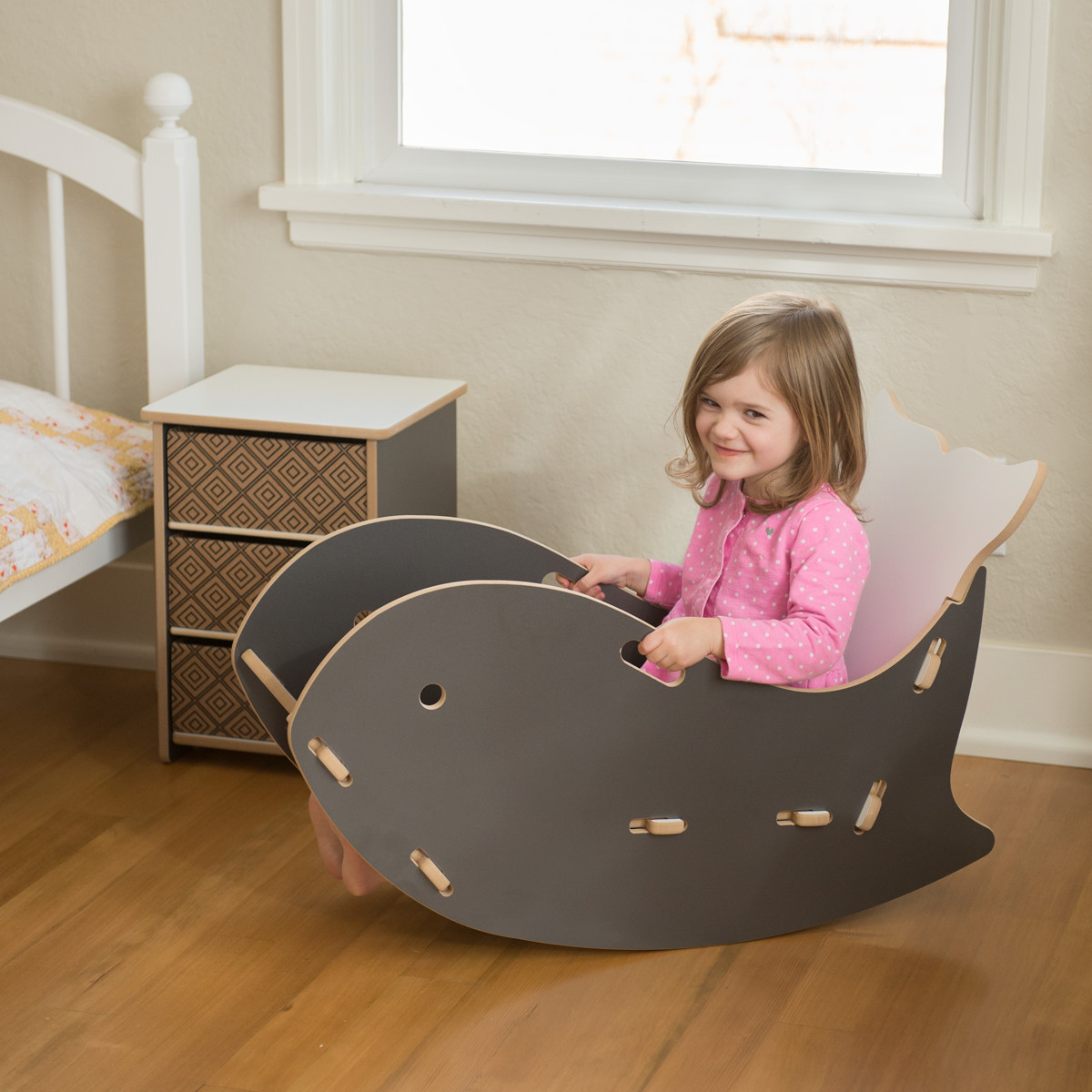 Adorable Little Girl Rocking In A Grey Whale Chair By Sprout Kid Furniture Kids Rocking Chair Rocking Chair Nursery Nursery Chair