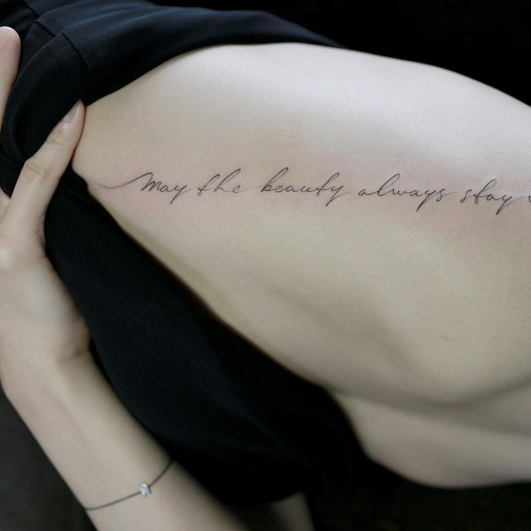 Script lettering on rib . tattoo tattoos tattooing
