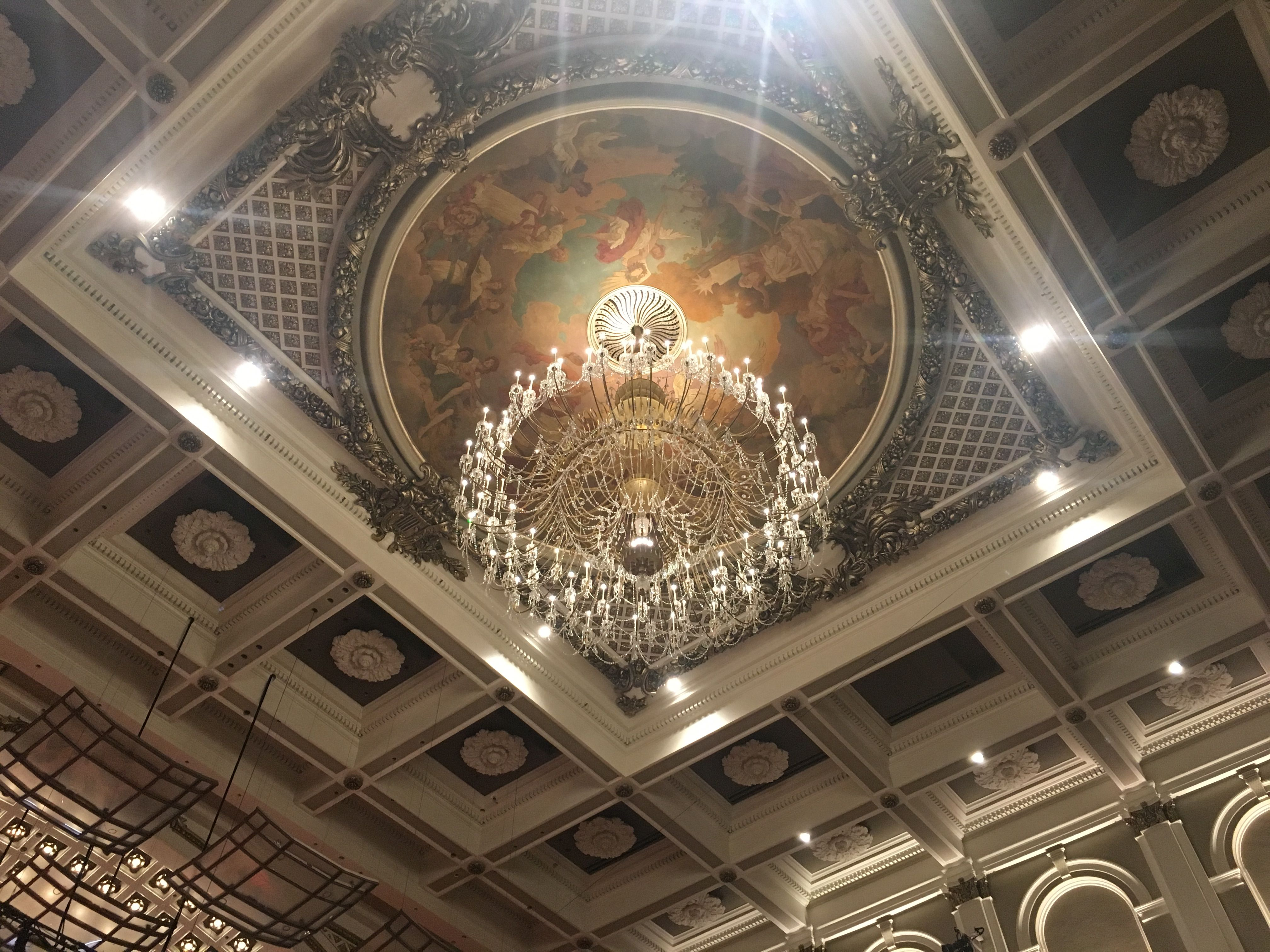 Ceiling Mural And Chandelier In