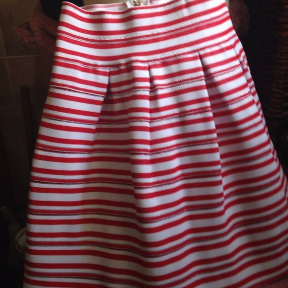 LM LuLu skirt It's red and white striped! It's from Le Show room. It's 35% polyester and 65% cotton. LM LULU Skirts