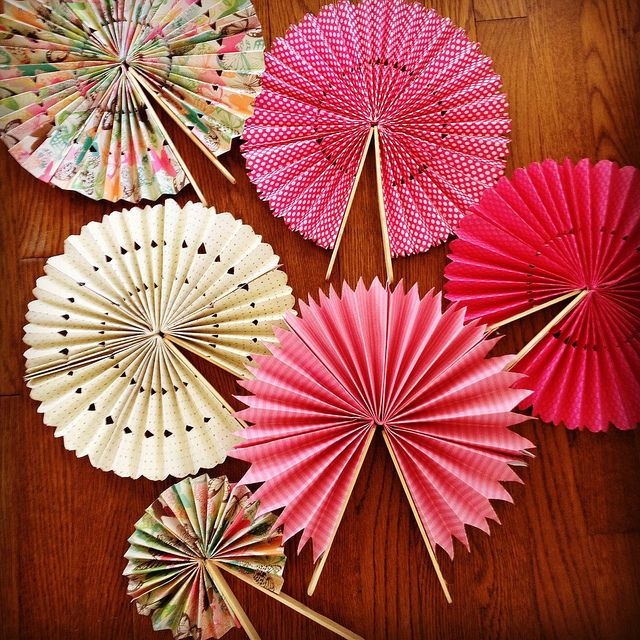 DIY Paper Fans. Cute idea for outdoor weddings and place on each guest seat. It's going to be hot!