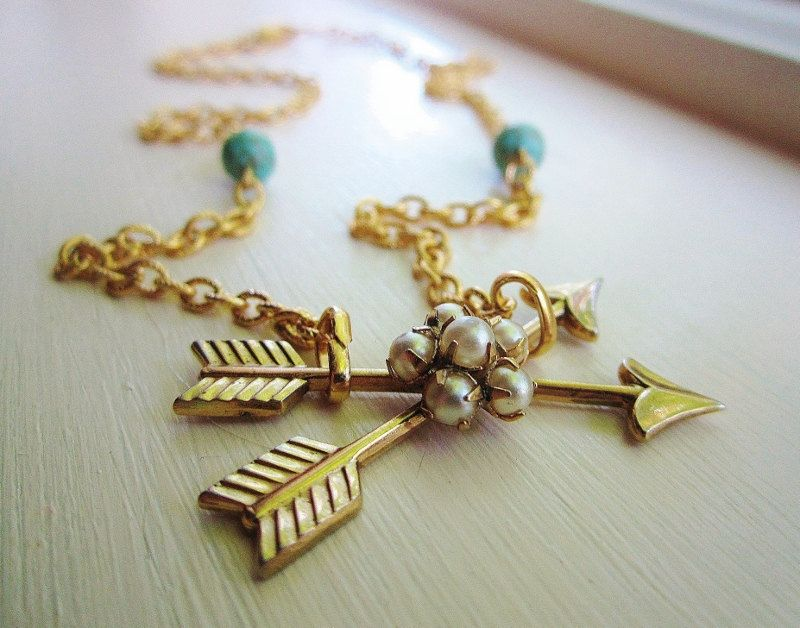 Necklace with turquoise beads and vintage arrows and pearl charm