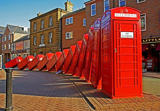 """David Mach's """"Out of Order"""" sculpture - London Red Telephone boxes (Kingston Upon Thames)."""