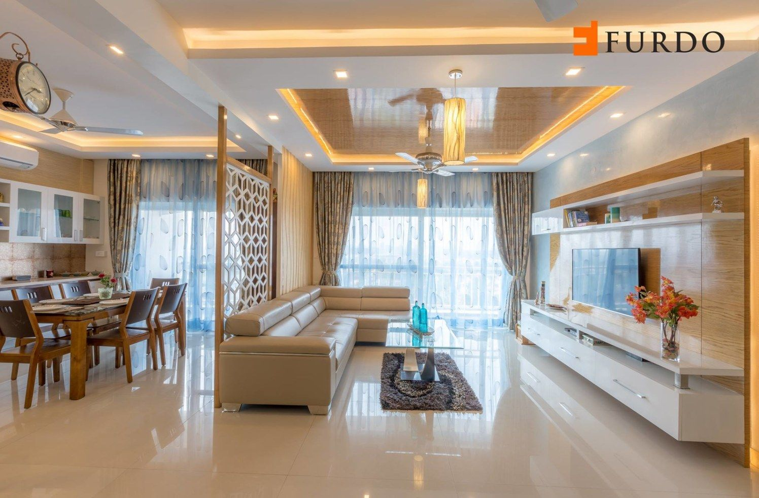The Living Room With L Shaped Sofa And Artistic False Ceiling By
