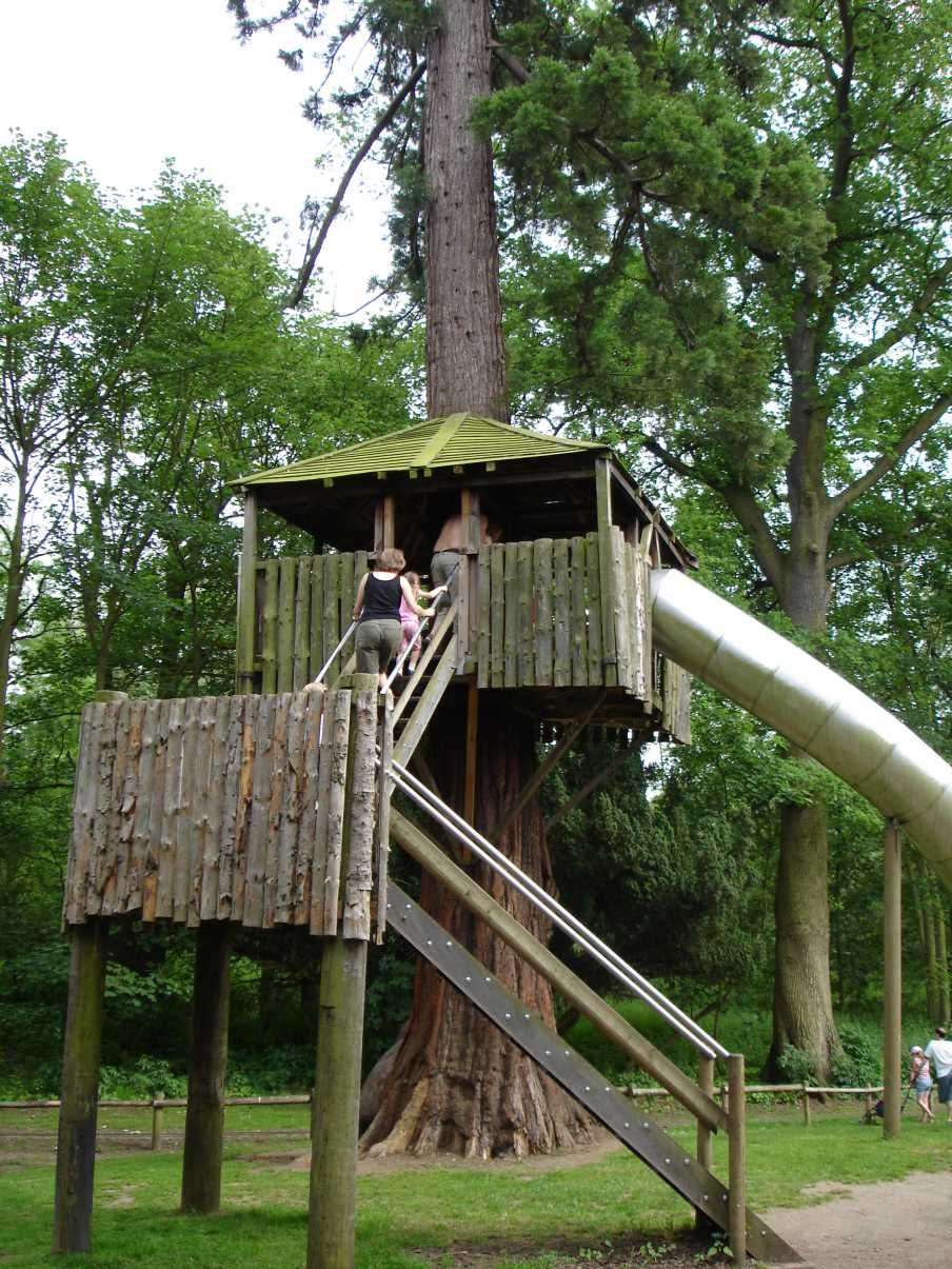 I like the idea of having a giant metal slide coming down out of the tree house.