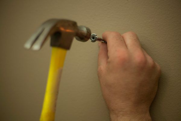 How to hang heavy things without nails drywall Hang up paintings without nails