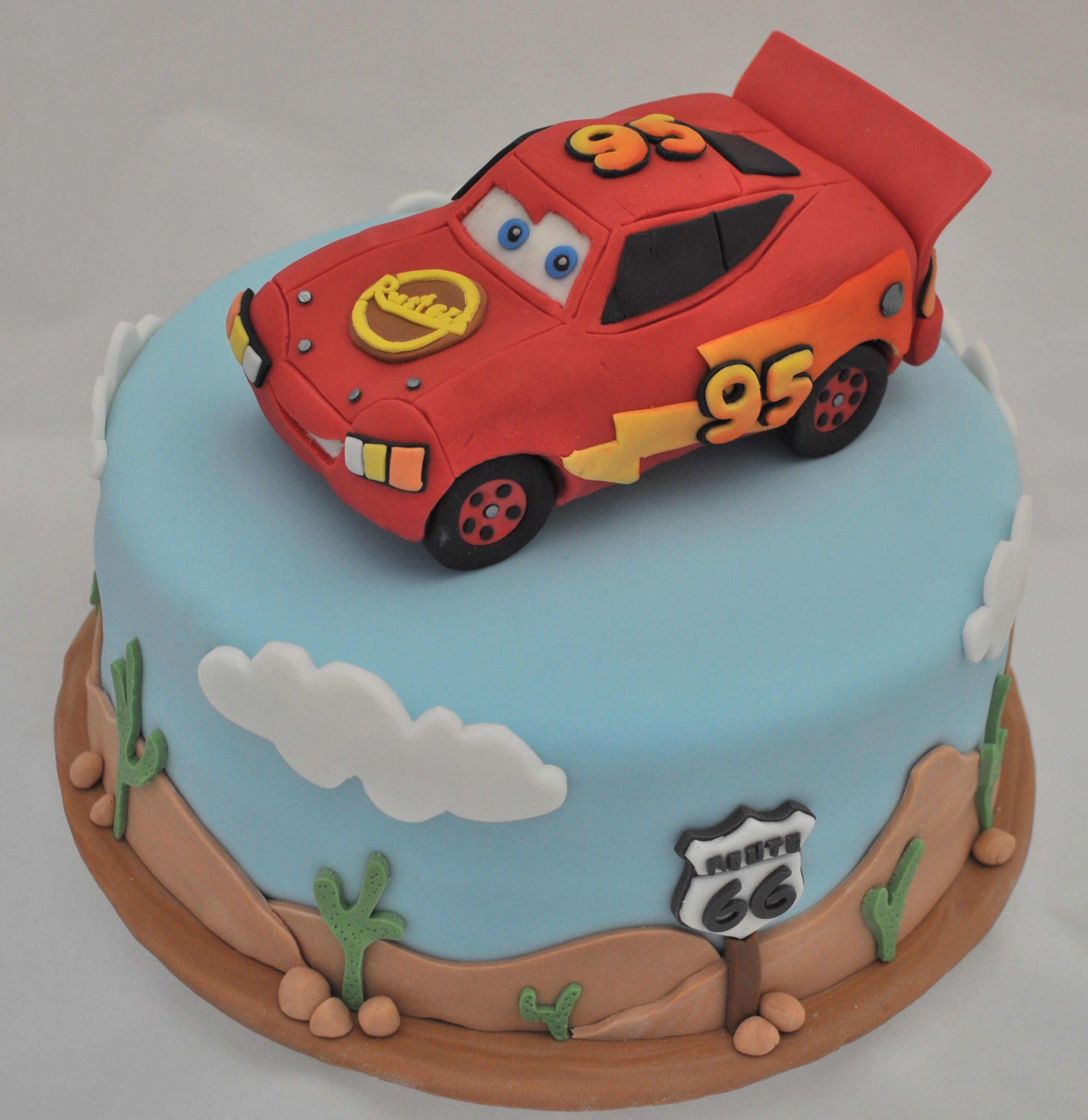 Lightning McQueen and Route 66 This cake was for a super Lightning