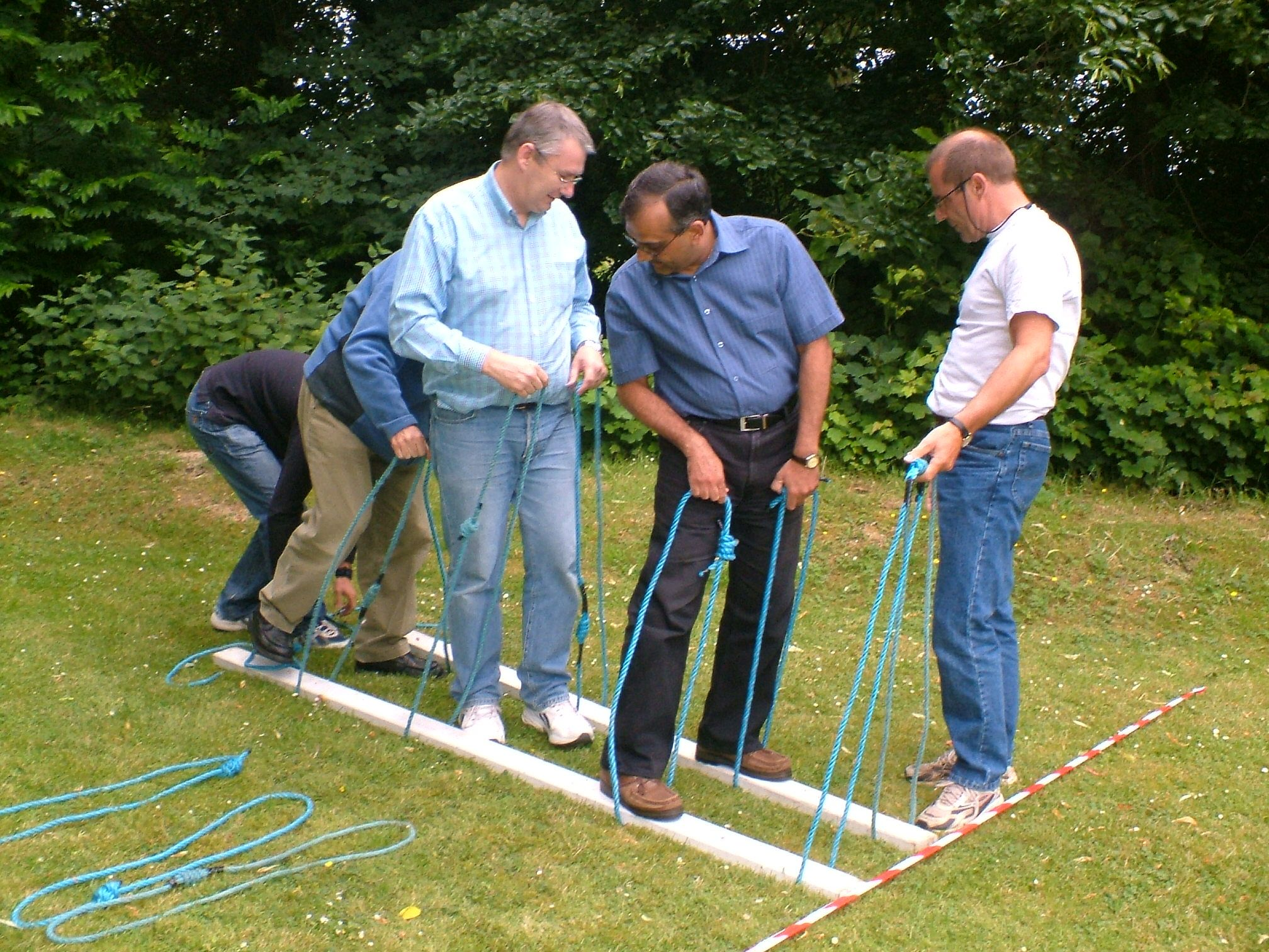 You will need 2 short planks per team and 2 rope or cloth - Team building swimming pool games ...