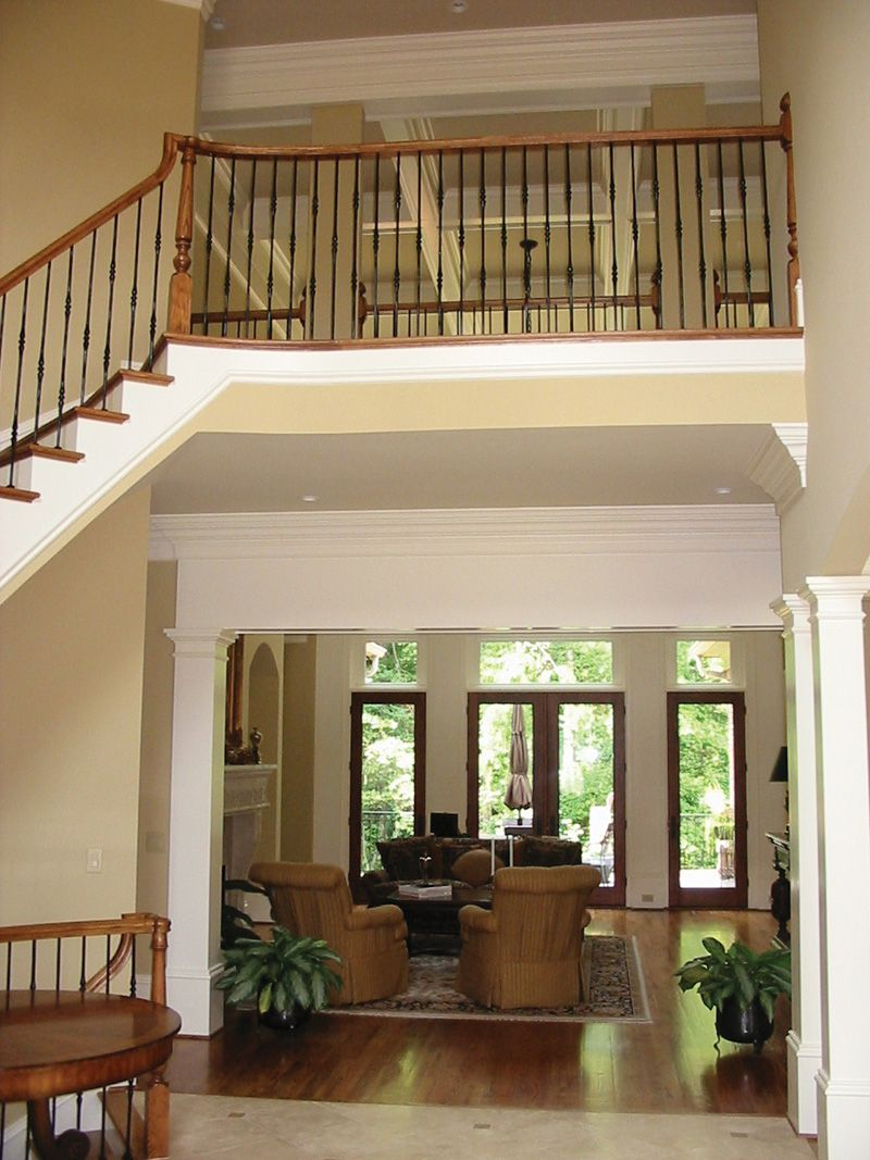 Enticing indoor balcony greets guests into this amazing for Balcony 2nd floor