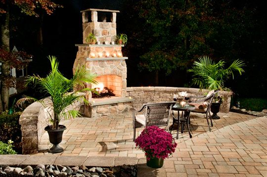 A Beautiful Outdoor Fireplace Using Our VERSA LOK Veranda Wall In Butternut  With Antiqued Texture Finish.