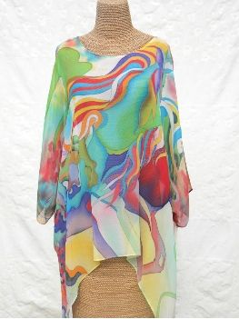 100% Silk Poncho   This handpainted poncho in silk georgette floats from the shoulder