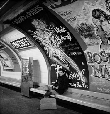 A passenger waits on the platform at the Metro station Abbesses in Paris, 1965. Paul Almasy