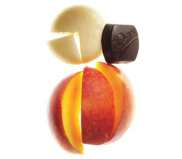 Piece of low-fat cheese, a small peach, and a piece of dark chocolate.