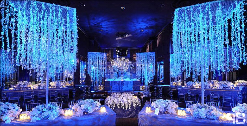 Winter Wonderland Wedding With Blue Lighting And Hanging Crystals Winter Wedding Decorations Winter Wonderland Wedding Wedding Themes Winter