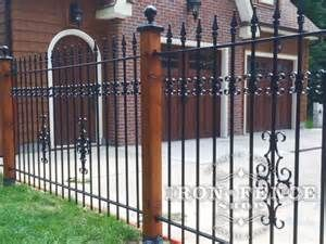 Wood Posts With Wrought Iron Fence For A Custom Look Iron Fence Wrought Iron Fences Iron Fence Metal Fence
