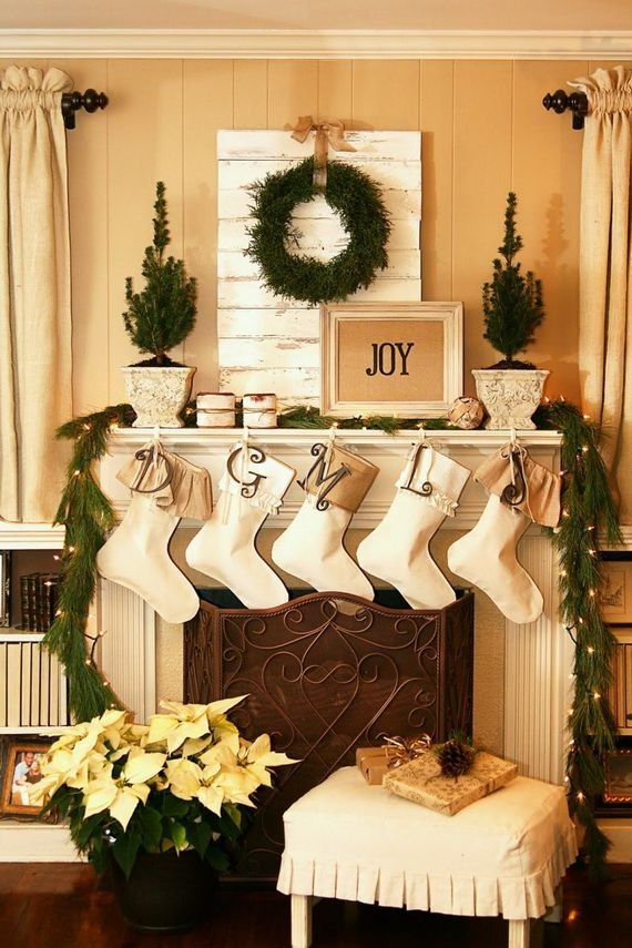 Furniture And Accessories. Joyful And Bright Christmas Living Room  Fireplace Mantel Decoration In Natural Green And Cream Color Theme.