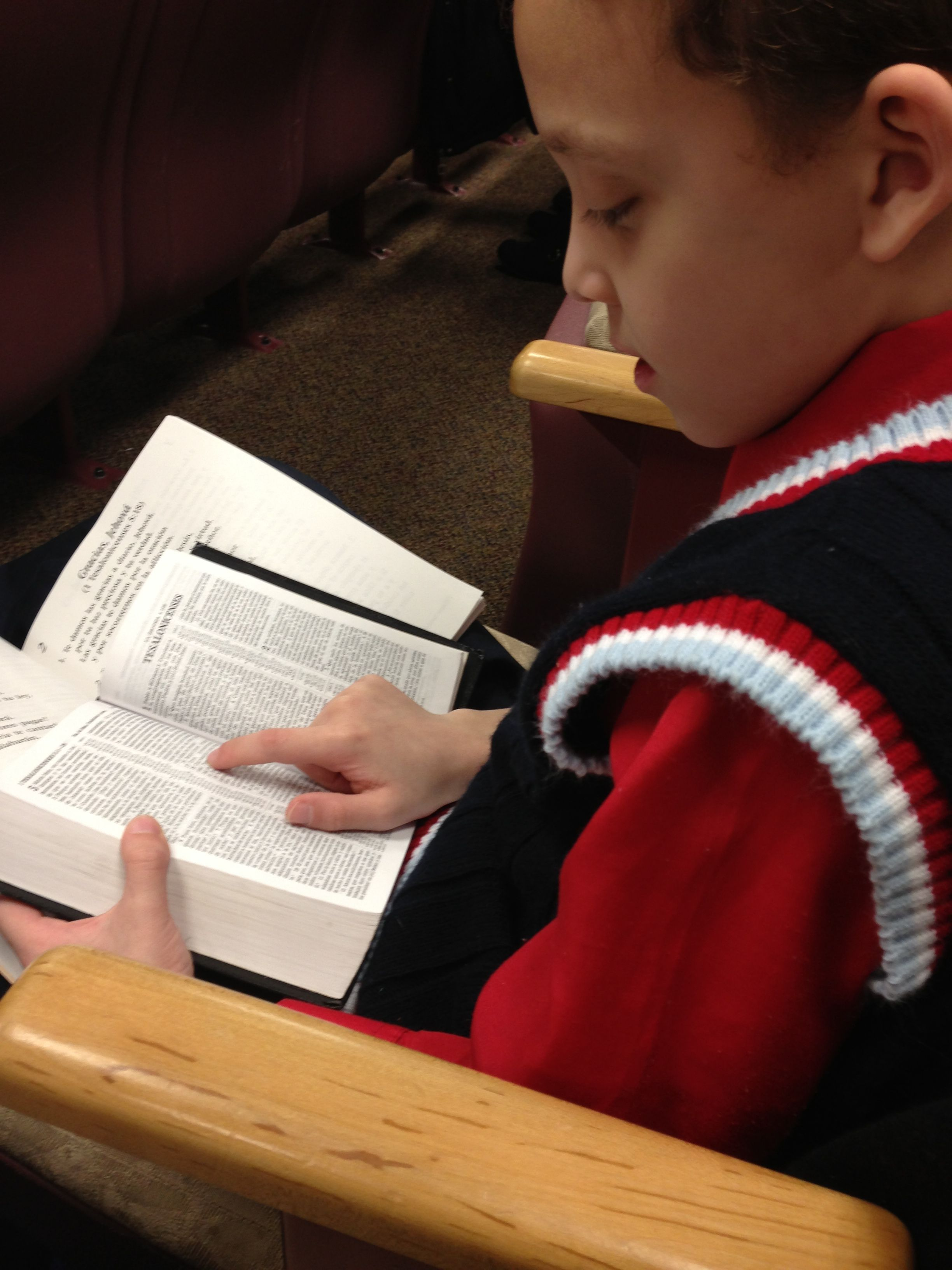 My son reading the bible at meeting...  So cute!!!