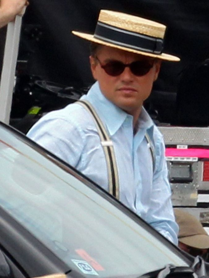 Leonardo DiCaprio wearing a classic straw boater style hat.  d9523195334