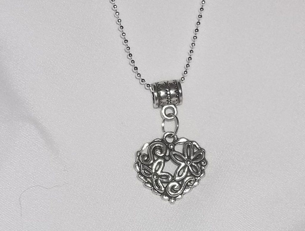 Heart floral cutout pendant 22 925 sterling silver chain heart floral cutout pendant 22 925 sterling silver chain aloadofball Image collections