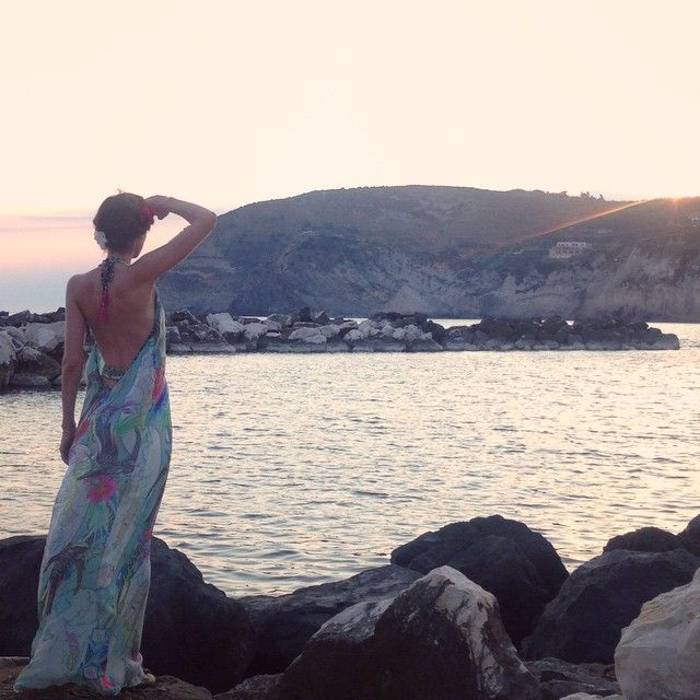 Rosanna Falconer wearing the Matthew Williamson atlas print backless gown from the summer 2015 collection. Pictured watching the sunset in Ischia, Italy #ohMW
