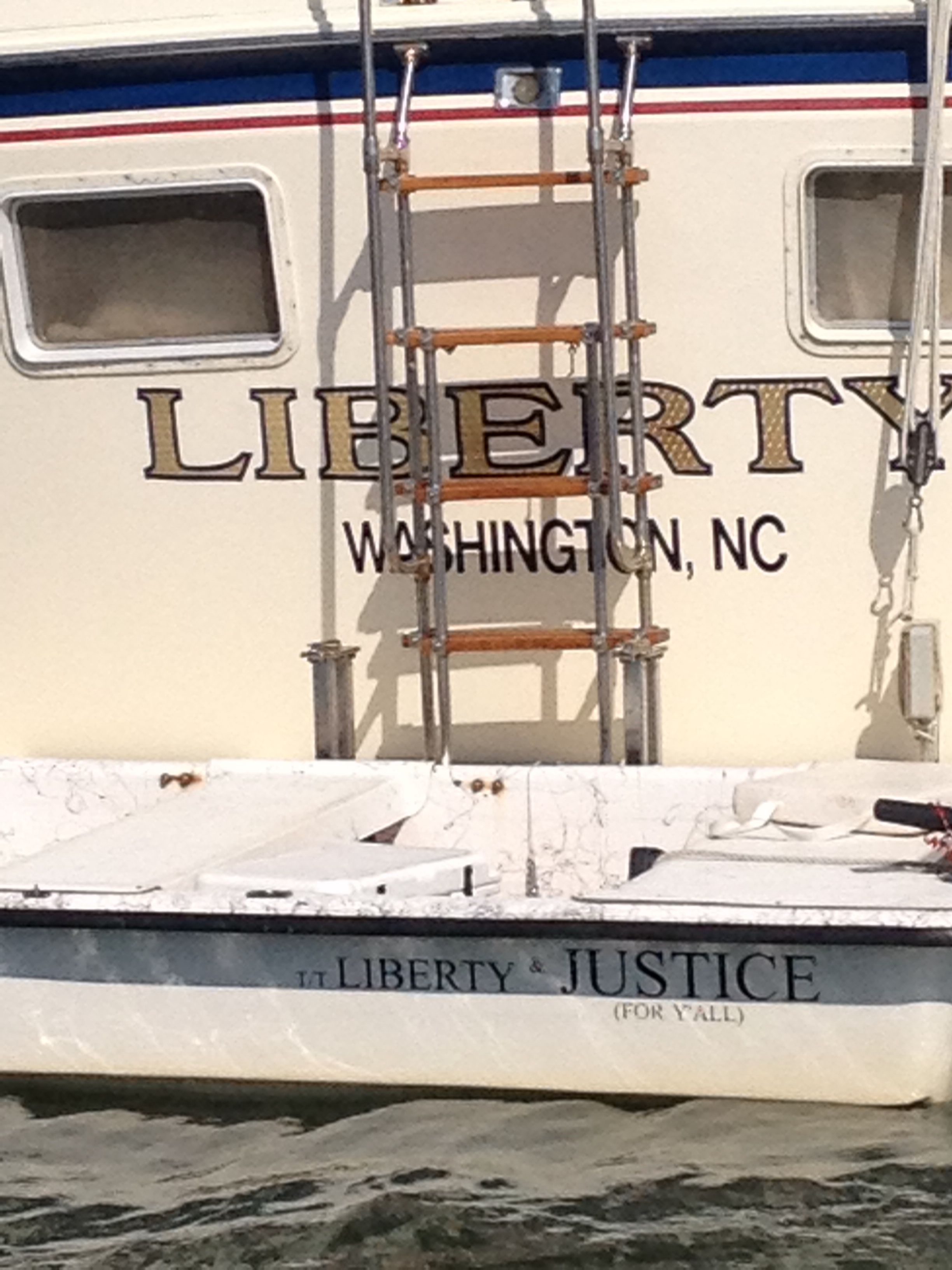 Look Closely At The Dinghy S Name In Front Of Liberty I Am