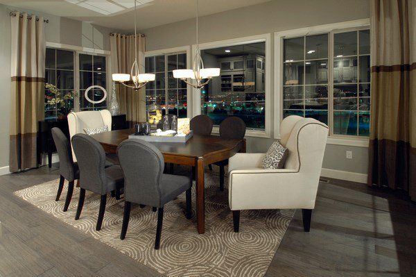 Formal Dining Room Design Gray Flooring White Chairs Modern Lighting