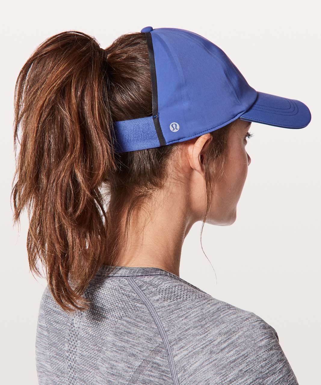 58619e6b481d7 Color  moroccan blue. Run fast and let your hair free in this sweat-wicking  hat with a wide-back opening to help keep you cool.