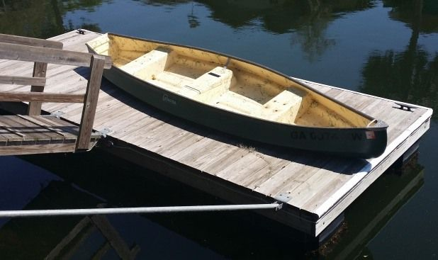 16 ft  4-person canoe w/ flat back (for motor) included in rental