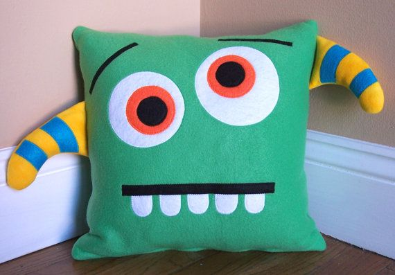 Geen Monster/Silly Face Pillow from 3 Silly Monkeys on Etsy.  14x14 pillow made from soft fleece.  $15.00
